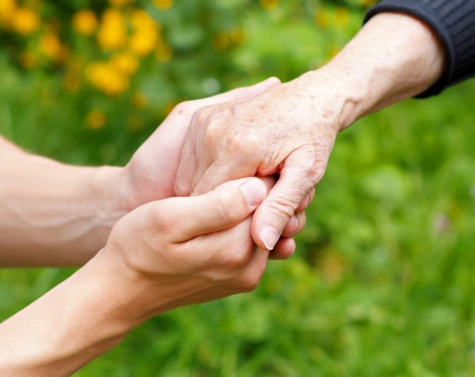 holding hands at assisted living home