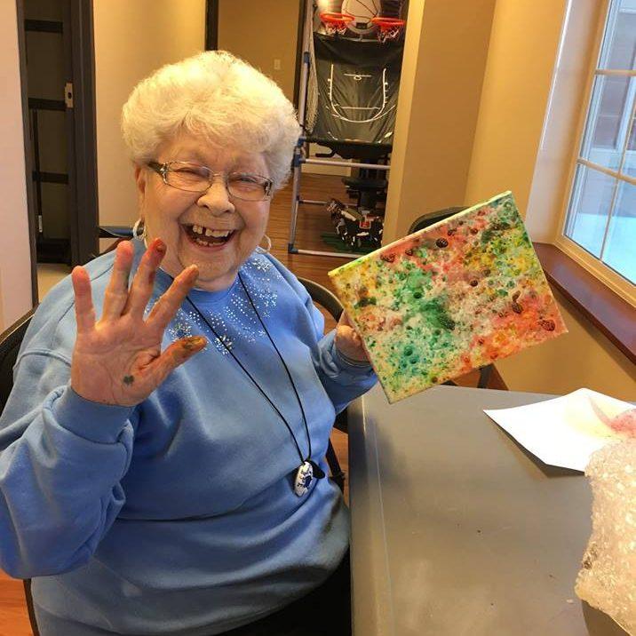 Elderly woman fingerpainting