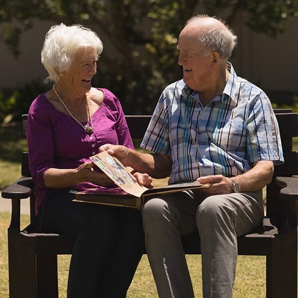 Assisted Living couple on bench